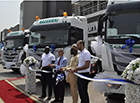 Top Executives of JMTC joined by guests to cut tape to unveil the trucks