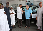 Mr. Jalal Kalmoni (2nd Right) leads Japan Motors team to hand over keys to the vehicle to Dr. Mustapha Hamid